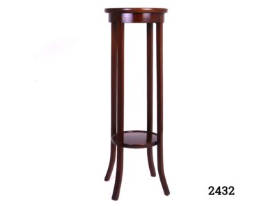 Antique circular mahogany plant stand Top shelf measures 310mm in diameter and bottom shelf 255mm in diameter Main photo showing the stand in its entirety