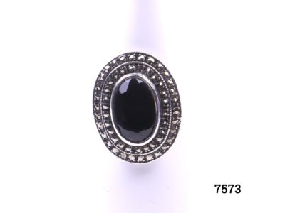 925 Sterling silver ring with black onyx and marcasite. Size Q / 8. Ring frontage measures 23mm by 20mm Main photo of ring displayed on stand showing frontage
