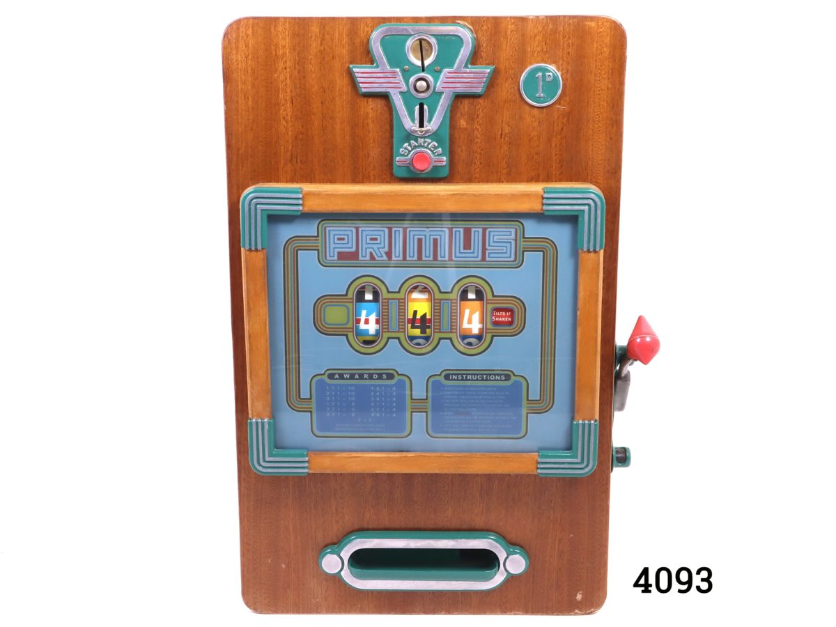 Primus one arm bandit slot machine c1958 by A Wulff & Co of Germany.  Operates on the old penny (1d) In good working order (Operates smoother with unworn old pennies) Main photo showing front of the machine