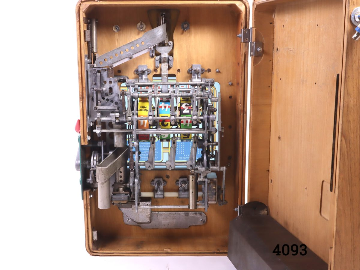 Primus one arm bandit slot machine c1958 by A Wulff & Co of Germany.  Operates on the old penny (1d) In good working order (Operates smoother with unworn old pennies) Photo of the inside of the machine showing the mechanisms