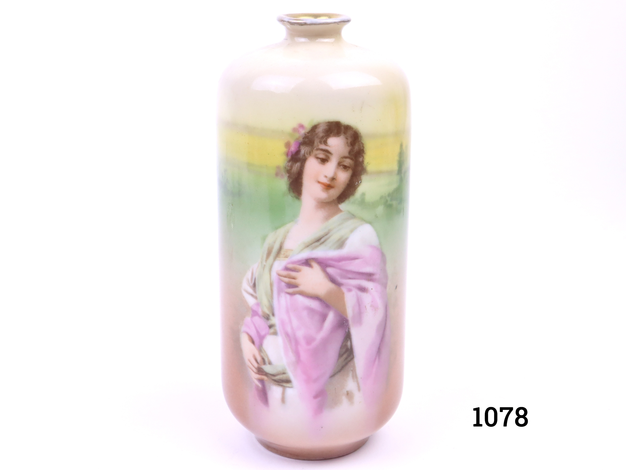 Royal Bayreuth small porcelain vase with hand-painted young maiden and rural background (Some wear to the gilt around the lip) Measures 50mm in diameter at base and 18mm across lip Main photo showing image of lady straight on