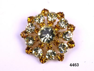 """Vintage costume jewellery brooch """"Sunrise"""" in lemon and amber coloured glass stones Measures 35mm in diameter Photo of brooch front"""