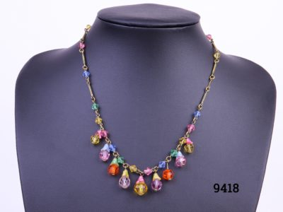 Vintage costume jewellery necklace with fruit salad glass droplets (one small piece missing) Secure barrel screw clasp Photo of necklace displayed on stand with missing piece visible