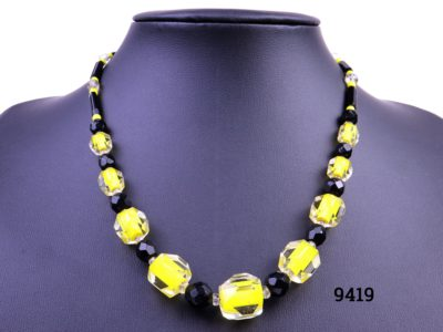 Vintage glass Deco style necklace Vintage costume jewellery necklace with yellow and black glass beads in an Art Deco style One photo showing necklace displayed on stand showing the graduated beads in alternating colours of yellow and black