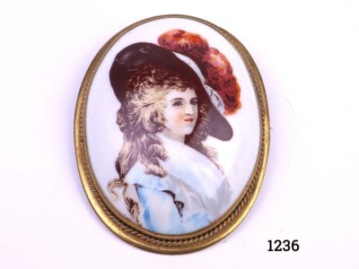 Vintage pinchbeck set brooch. Victorian ceramic brooch in a pinchbeck mount with a hand-painted image of a lady in the style of Thomas Gainsborough Main photo of front image of brooch