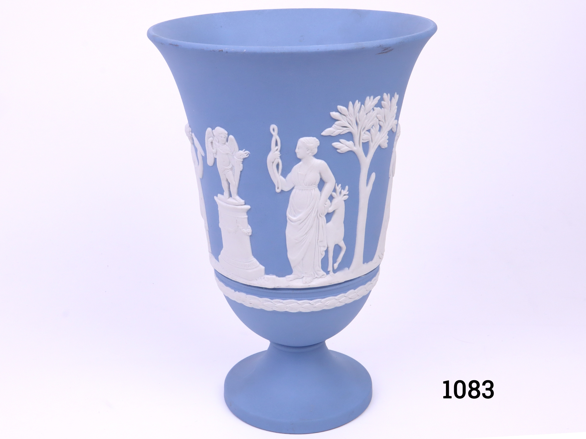 Vintage Wedgwood Jasperware vase in the classic light blue c1975 Measures 76mm in diameter at base and 130mm in diameter across the top Main photo of vase looking straight on
