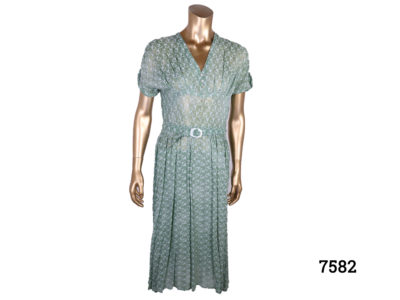 Vintage 40s style green silk voile dress with emroidered pattern throughout Side zip Size 10-12 Main photo of dress from front view displayed on a mannequin