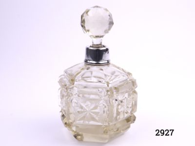 c1914 scent bottle in cut glass with silver band around the neck Londons assayed (Small chip on the glass stopper) Measures 85mm in diameter at base Main photo of the whole scent bottle
