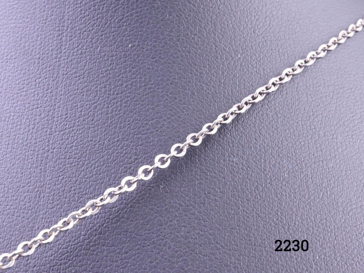 925 Sterling silver Modernist style pendant on silver chain Pendant measures 33mm by 30mm Close up photo of the chain