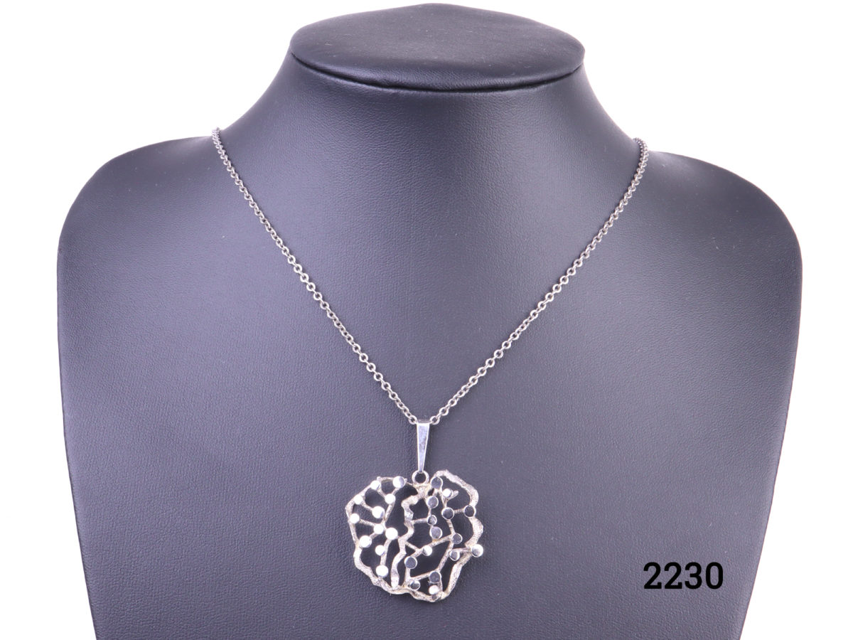 925 Sterling silver Modernist style pendant on silver chain Pendant measures 33mm by 30mm Main photo showing necklace displated on a stand from front view