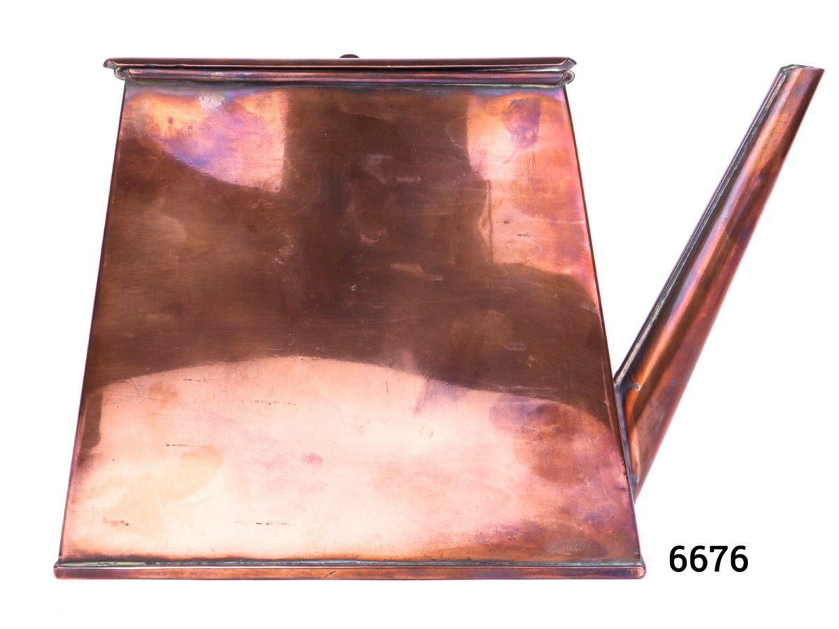 Antique copper watering can in an ingenious space saving shape with handle to the side Barge ware Main photo showing side without the handle