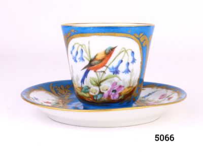 Antique Sèvres cup and saucer hand-painted in gilt and turquoise blue with exotic bird with flowers on the cup and flowers on the saucer. Cup measures 40mm in diameter at base and 75mm across the top. Saucer measures 140mm in diameter Main photo of cup and saucer showing bird decoration on cup