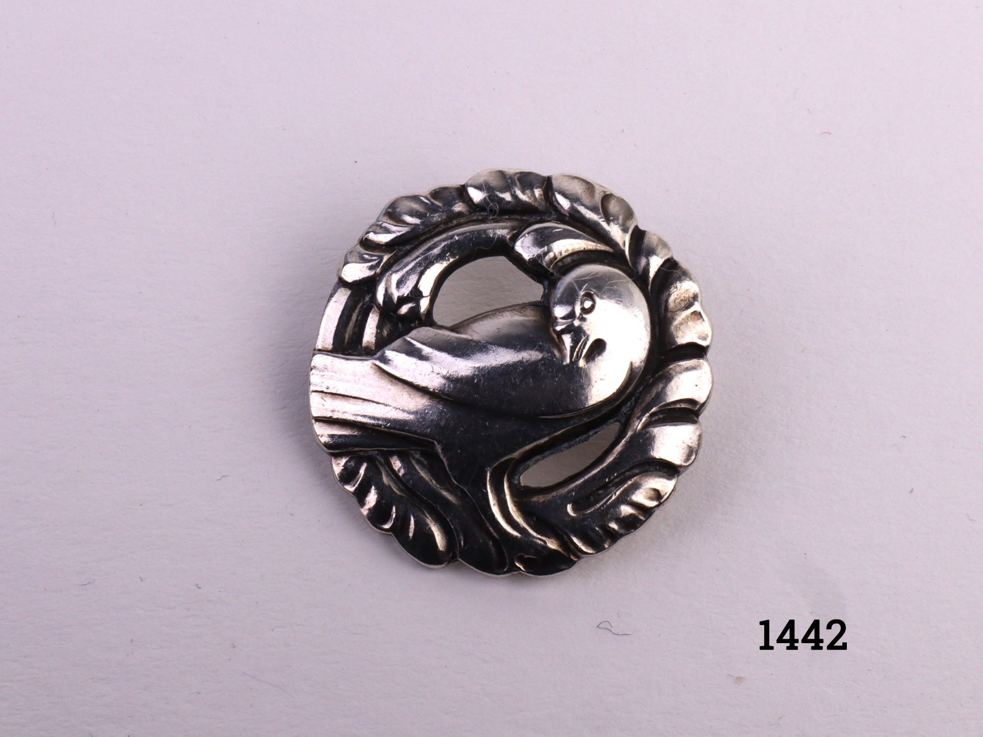 Small Georg Jensen sterling silver dove brooch. Hallmarked Sterling Denmark 191 with iconic encircled Georg Jensen mark. Measures 25mm in diameter and weighs 4.5 grammes Main photo of brooch front with dove