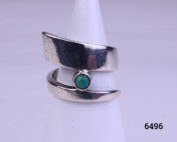 Modernist style vintage silver ring. Vintage sterling silver ring in an asymmetrical twist design with single small turquoise stone accent Size M.5 / 6.5 Main photo showing ring front displayed on a stand