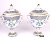 Pair of antique lidded urns by Dresden potteries. Handpainted in pale blue and gilt with floral design. Both in excellent condition. Measures 56mm in diameter at base Main photo showing both urns side by side