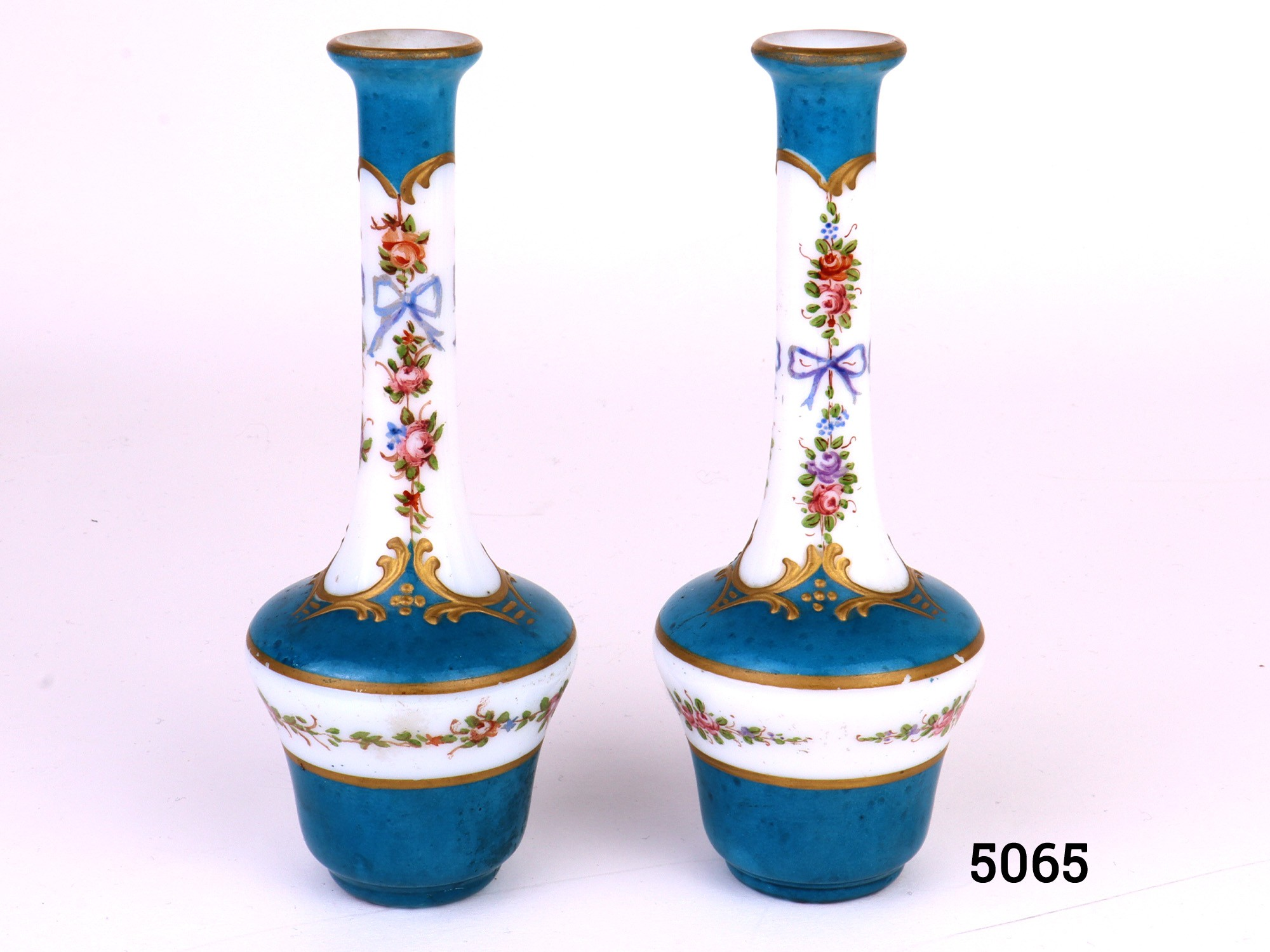 Antique pair of miniature French glass vases handpainted in turquoise blue and gilt and decorated wih flowers and ribbons. Measures 25mm in diameter at base and 10mm at opening at top Main photo showing both vases side by side