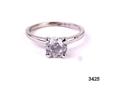 Vintage round brilliant cut 1.2 carat diamond solitaire reset onto modern 14kt white gold ring. SI1 clarity diamond with E colour. Box included. Size M.5 / 6.5. Weight 2.6g Main photo showing front view of ring on flat surface