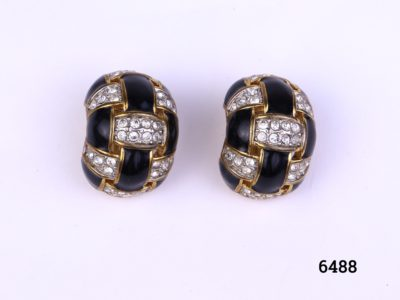 Vintage Ciro clip-on earring with rhinestones and black enamel on gilt metal.    Clips on both in good order (One is slightly looser than other). Front of earrings measures 25mm by 20mm Main photo showing front of earrings